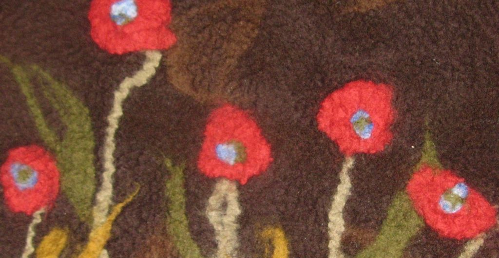red poppies pillow close up