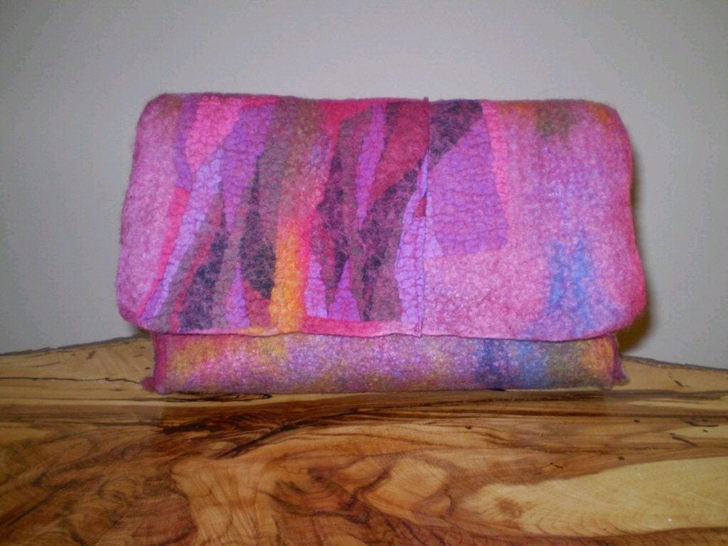 Flap of clutch incorporates some of the silk fabric which also lines the inside of the bag.