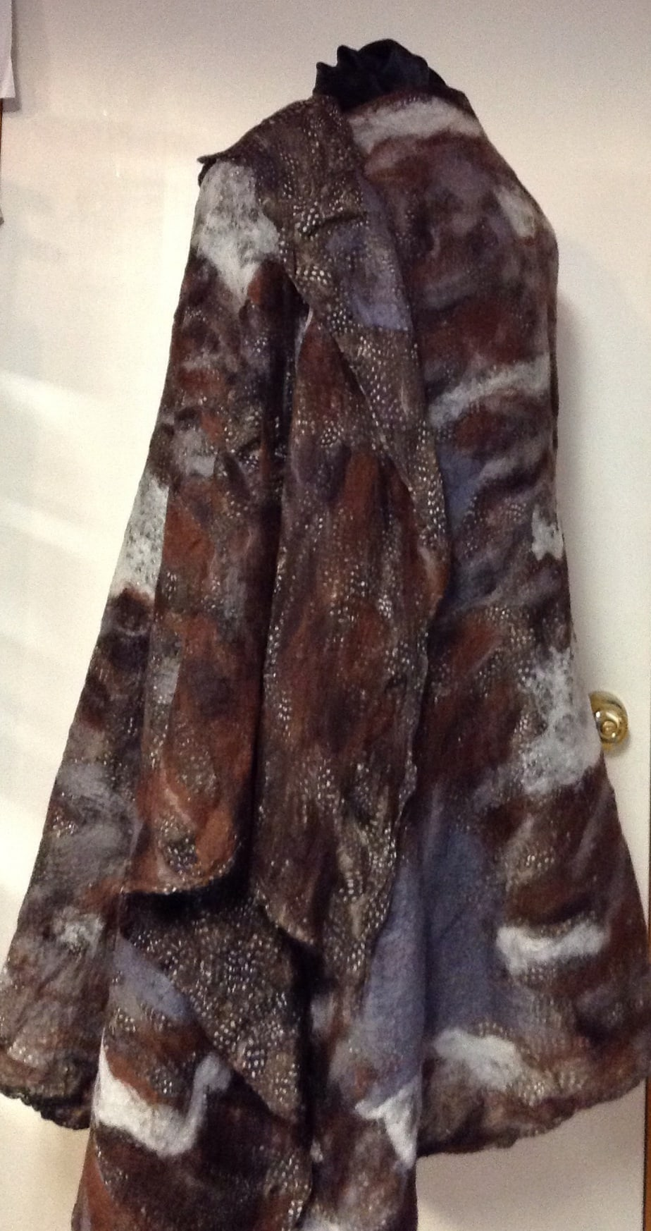 Hand dyed nuno felted silk too, zippered back.
