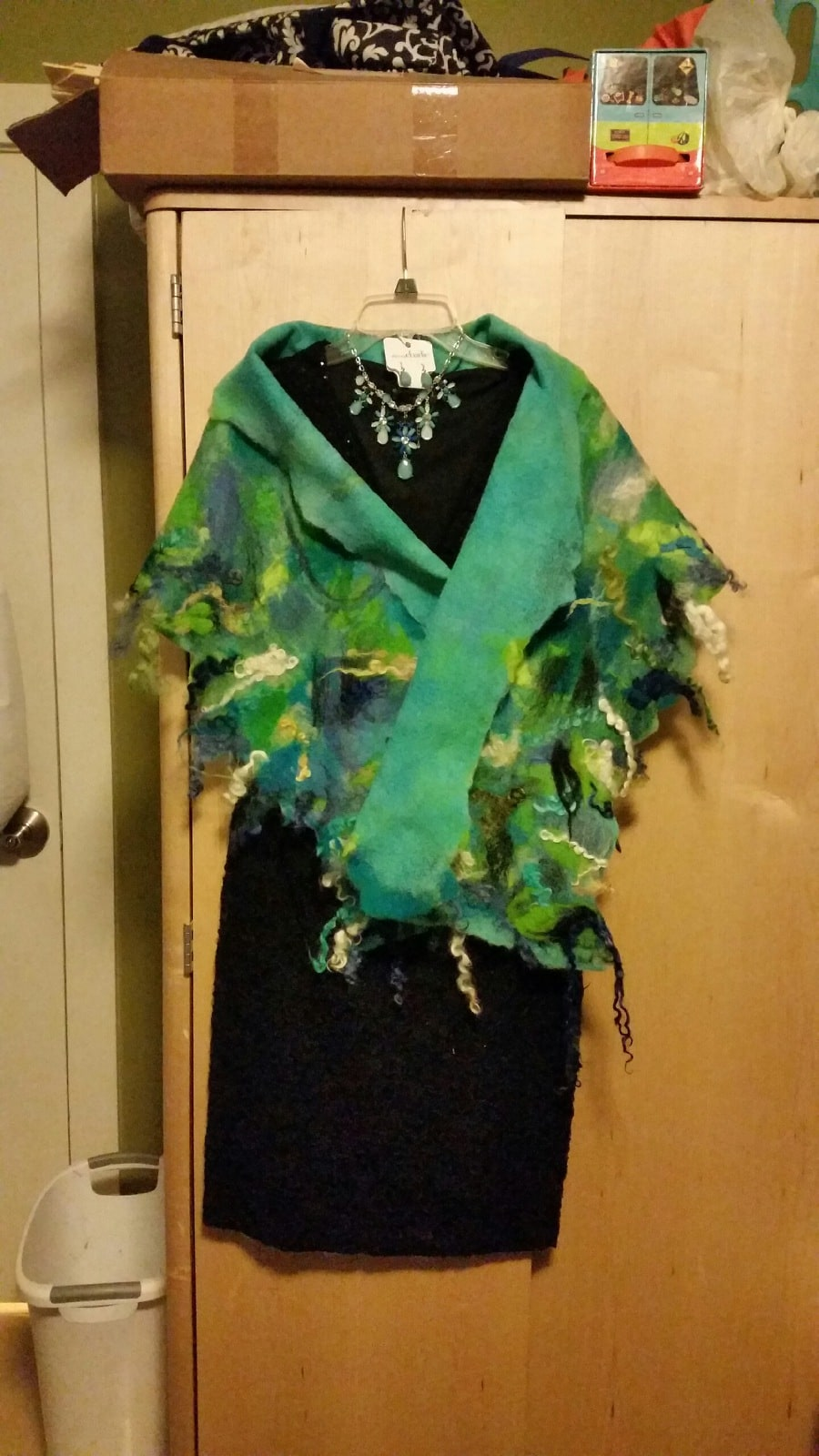This is a wet and needle felted shawl that was inspired by ocean colors.  The locks around the edge remind me of the waves at the beach.