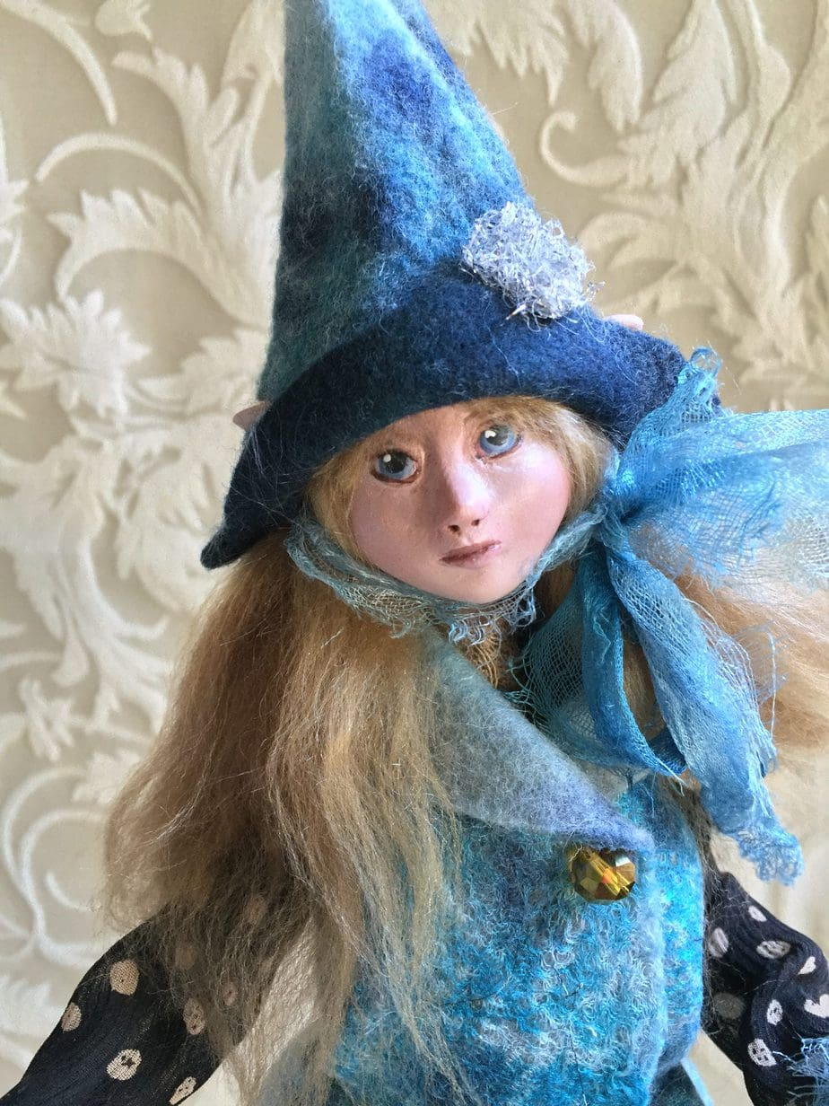 One of a kind art doll.  Hand felted clothing of wool and silk