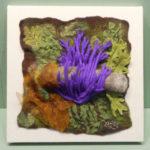 Purple fungus growing on a log