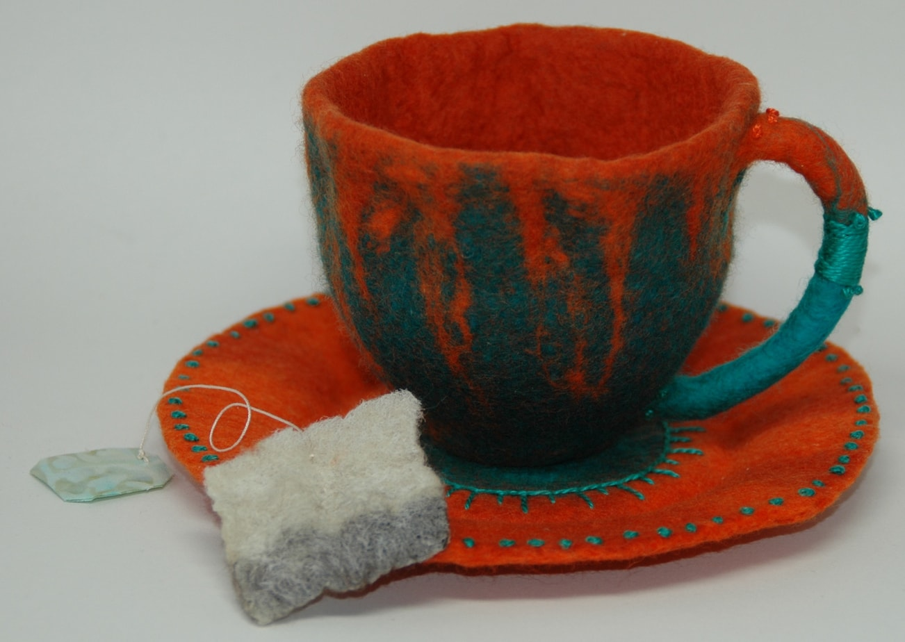 Wet felted wool, sillk, hand embroidery.