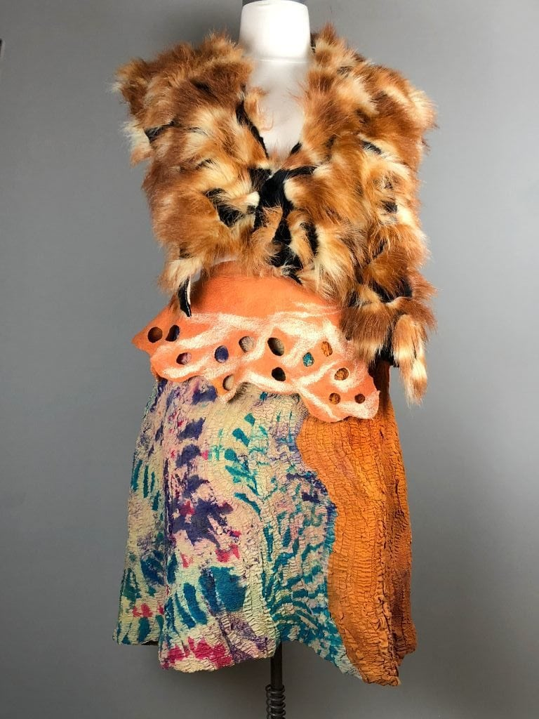 Felted skirt and wait band with fake fur vest.